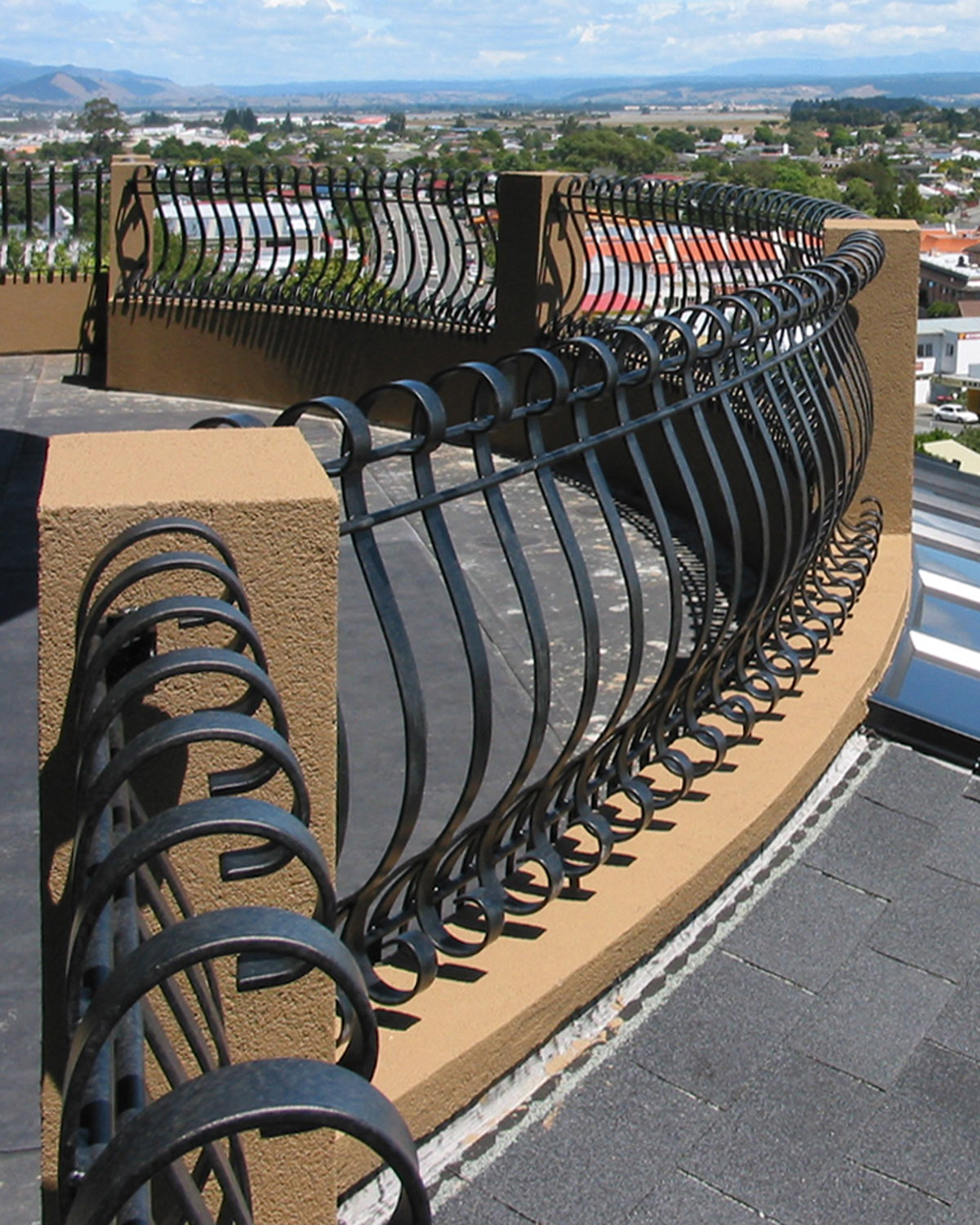 bowed rought iron balustrades from Tasman Forge, NZ