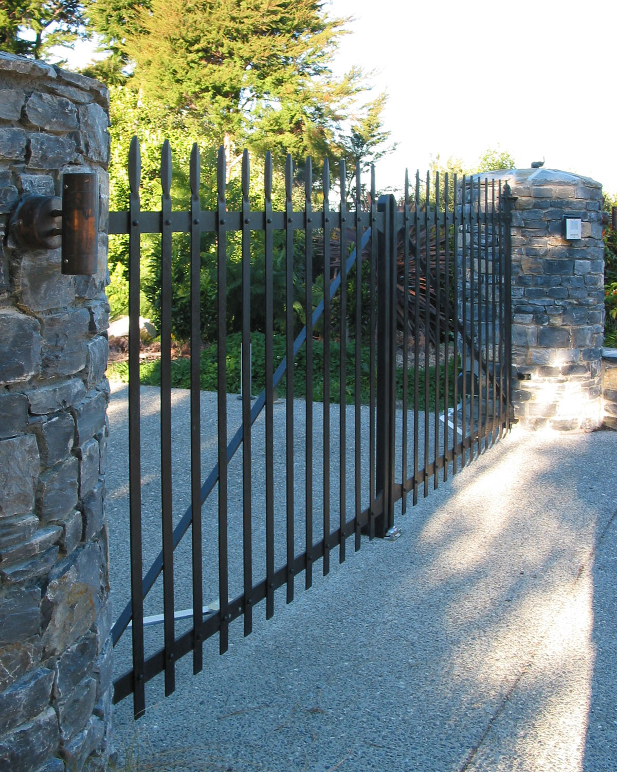 Riveted wrought iron driveway gates